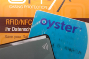 contactless payment card in protective sheath, and Oyster card